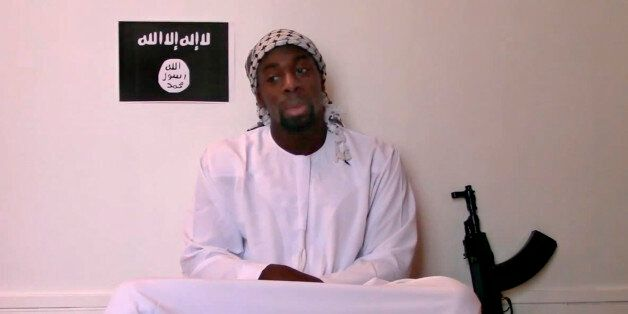 This image made from a video posted online by militants on Sunday, Jan. 11, 2015, shows slain hostage-taker Amedy Coulibaly,