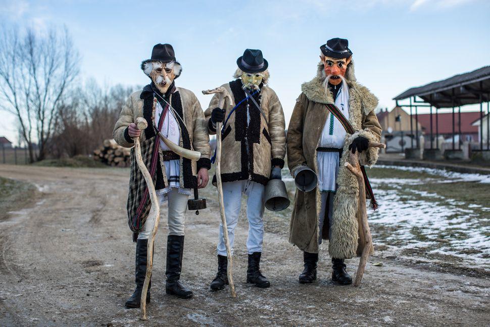 Villagers celebrating the winter festival of Malanka pose for a portrait in costume on January 14, 2015 in Krasnoilsk, Ukrain