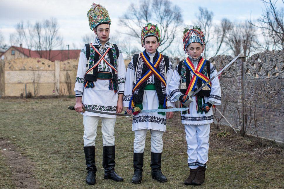 Villagers celebrating the winter festival of Malanka pose for a portrait in costumes on January 14, 2015 in Krasnoilsk, Ukrai