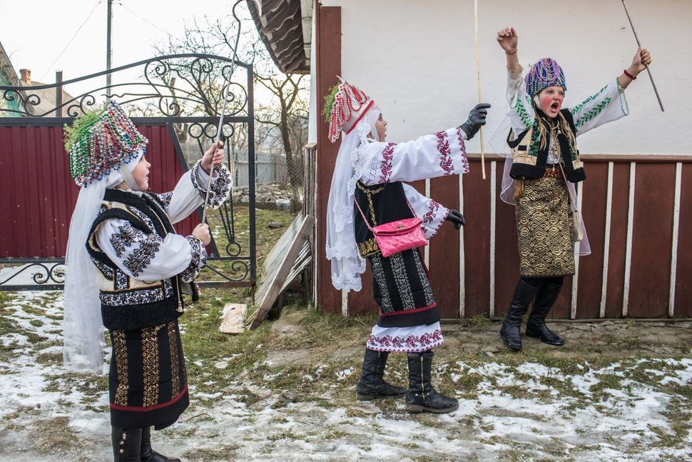 Children take part in the winter festival of Malanka on January 14, 2015 in Krasnoilsk, Ukraine.