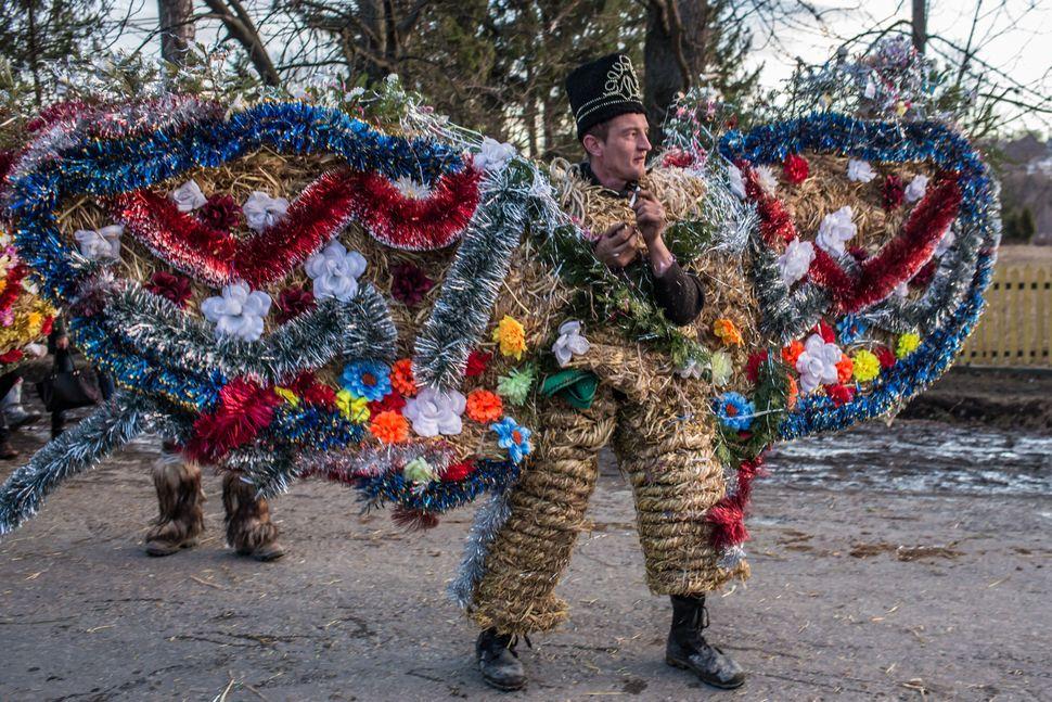 Villagers celebrate the winter festival of Malanka on January 14, 2015 in Krasnoilsk, Ukraine.