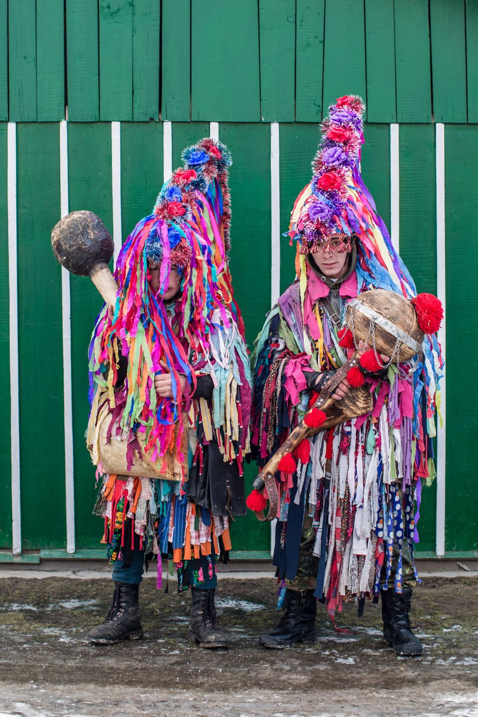 Villagers dressed in costumes as they celebrate the winter festival of Malanka pose for a portrait on January 14, 2015 in Kra