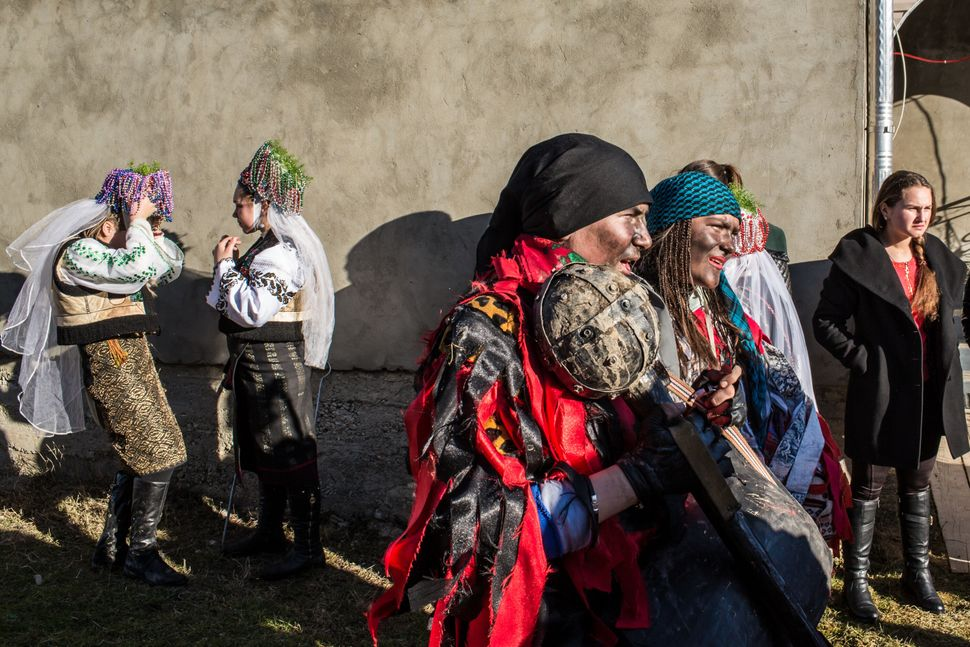 Villagers dress up in costumes as they celebrate the winter festival of Malanka on January 14, 2015 in Krasnoilsk, Ukraine.