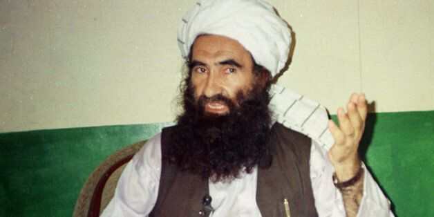 FILE- In this Aug. 22, 1998 file photo, Jalaluddin Haqqani, founder of the militant group the Haqqani network, speaks during