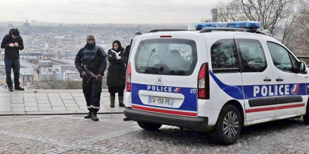French police officers patrol around the Sacre Coeur basilica at Montmartre district, in Paris, Monday, Jan. 12, 2015. France