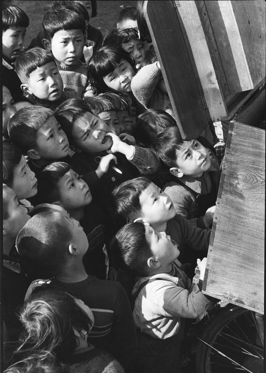 Children looking at a picture-card show. Tokyo, 1953.