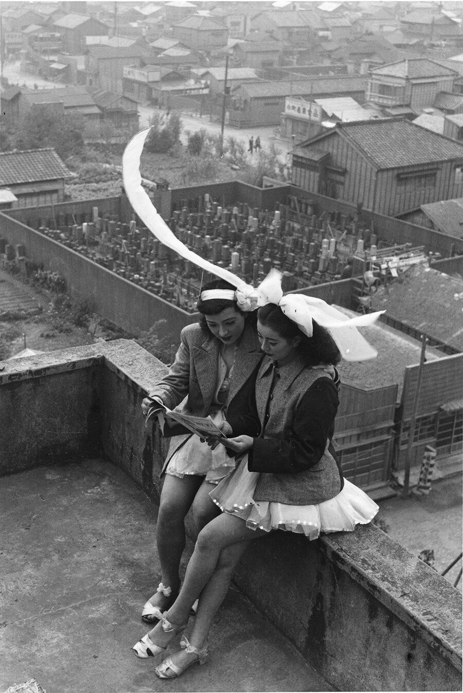 Dancers resting on the rooftop of the SKD Theatre. Asakusa, Tokyo, 1949.
