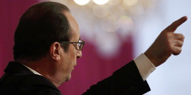 French President Francois Hollande delivers a speech during a New Year ceremony for business and employment sector representa