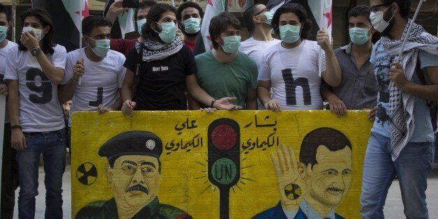 ALEOOI, SYRIA - 2014/08/21: A protest stand in the first anniversary of the chemical massacre in East Ghota in which hundreds