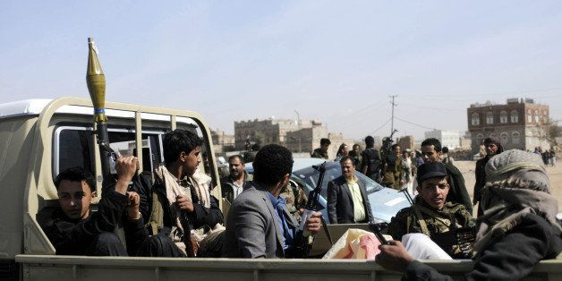 SANAA, YEMEN - JANUARY 19: Armed members of Houthis gather at Sebin Square as they close the Sebin Road to traffic near presi