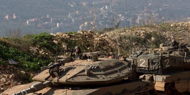 Israeli soldiers sit in tanks near the in Israel-Lebanon Border, northern Israel, Tuesday, Jan. 20, 2015. Israel is on high a