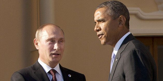 FILE - In this Sept. 5, 2013 file photo, President Barack Obama shakes hands with Russian President Vladimir Putin during arr