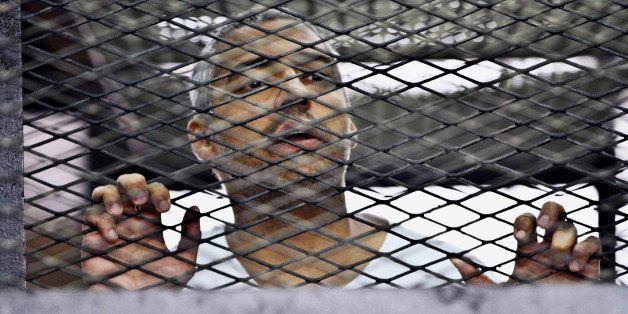 FILE - In this Thursday, May 5, 2014 file photo, Mohammed Fahmy, Canadian-Egyptian acting bureau chief of Al-Jazeera, appears