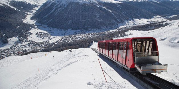 A cable train makes its way up the Weissfluhjoch mountain  in Davos, Switzerland, Monday, Jan. 19, 2015. The world's financia