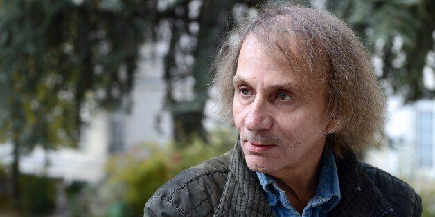French writer Michel Houellebecq poses on November 5, 2014 during his photo exhibition 'Before Landing' at the Pavillon Carre