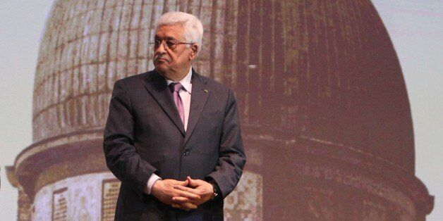 Palestinian President Mahmud Abbas waits to speak in the West Bank city of Ramallah on January 4, 2015. Abbas spoke about the