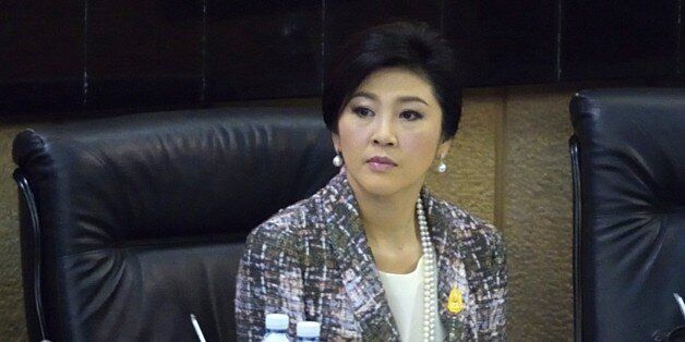 Ousted Thai prime minister Yingluck Shinawatra looks on as she faces impeachment proceedings by the military-stacked National