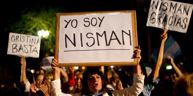 """A demonstrator holds a sign that reads in Spanish """"I am Nisman"""" during a protest sparked by the death of special prosecutor A"""