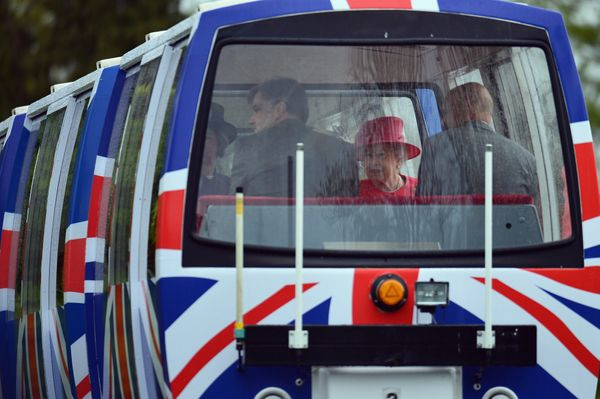 Queen Elizabeth II travels on a monorail during a visit to Chester Zoo as part of her tour of the North West on May 17, 2012