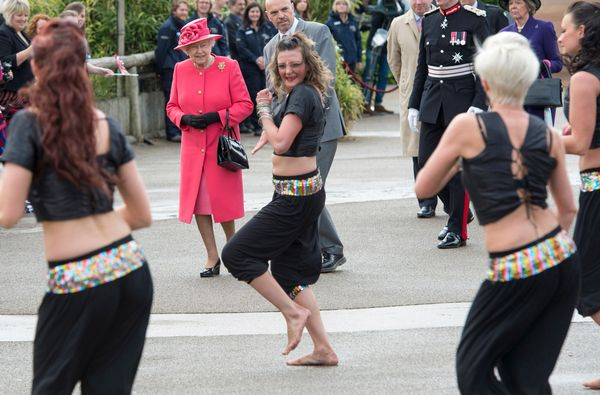 Queen Elizabeth II watches dancers perform as she visits Chester Zoo as part of her tour of the North West on May 17, 2012 in