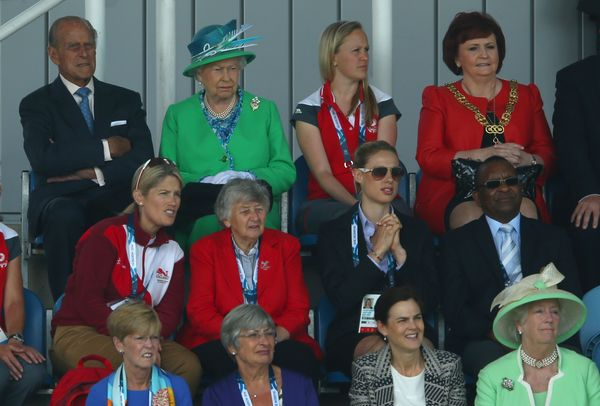 Queen Elizabeth II watches the Women's preliminary match between England and Wales as she visits the Glasgow National Hockey