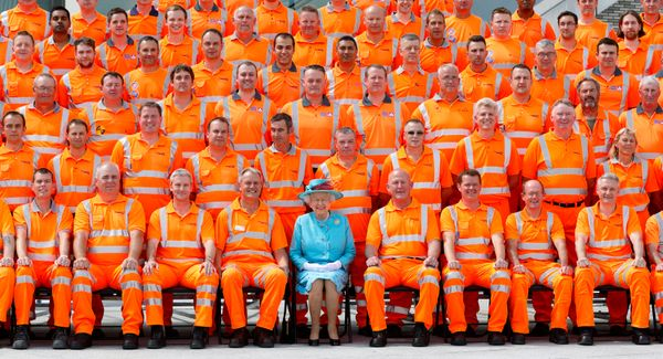 Queen Elizabeth II poses for a group photograph with Network Rail construction workers after opening the newly redeveloped Re