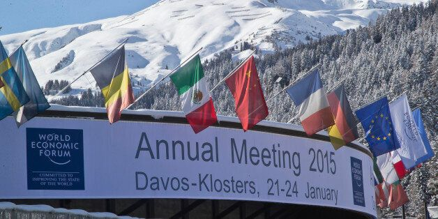 Flags hang on the roof of the Congress Hall were the World Economic Forum will take place in Davos, Switzerland, Monday, Jan.