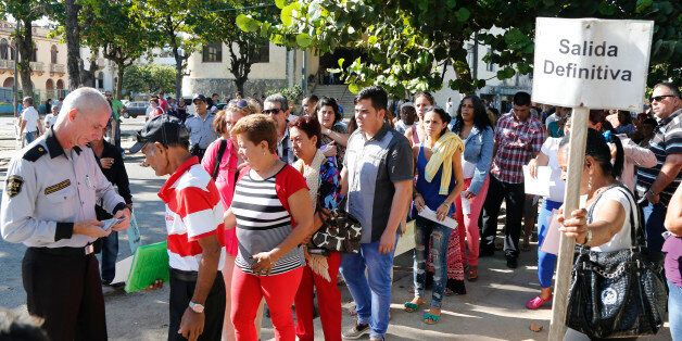 People queue for visas at the U.S. Interests Section in Havana, Cuba, Monday, Dec. 22, 2014. After the surprise announcement