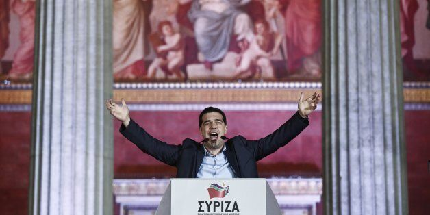 Leader of Syriza left-wing party Alexis Tsipras speaks to his supporters outside Athens University Headquarters, Sunday, Jan.