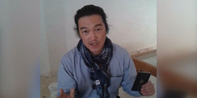 ALEPPO, SYRIA - JANUARY 29 :  A frame grab taken from a footage on October 24, 2014, shows Japanese journalist Kenji Goto Jog
