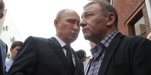 SAINT PETERSBURG, RUSSIA - AUGUST 09: Russian President Vladimir Putin (L) and billionaire  Arkady Rotenberg (R) attend the f