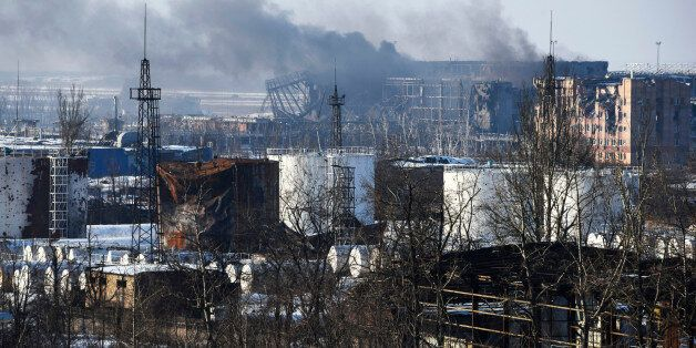 In this Thursday, Jan. 15, 2015 photo, smoke rises over the new terminal of Donetsk airport in Donetsk, Eastern Ukraine. Russ