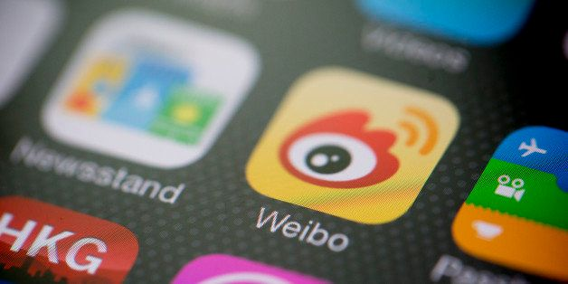 Sina Corp.'s Sina Weibo microblogging service app icon is displayed on an Apple Inc. iPhone 5s in an arranged photograph in H