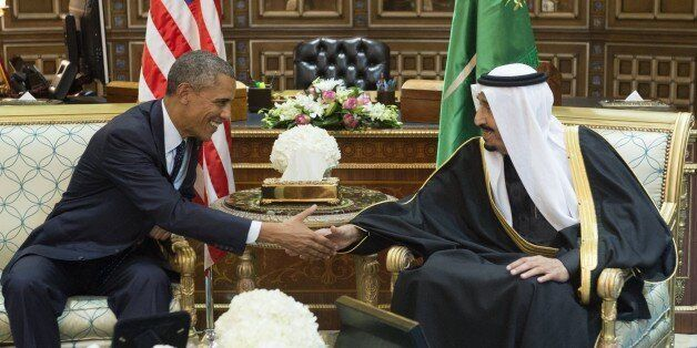 Saudi's newly appointed King Salman (R) shakes hands with US President Barack Obama at Erga Palace in Riyadh on January 27, 2