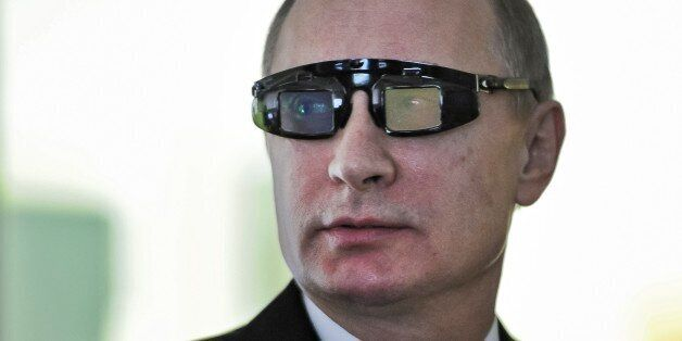 Russian President Vladimir Putin wears special glasses as he visits a research facility of the St. Petersburg State Universit