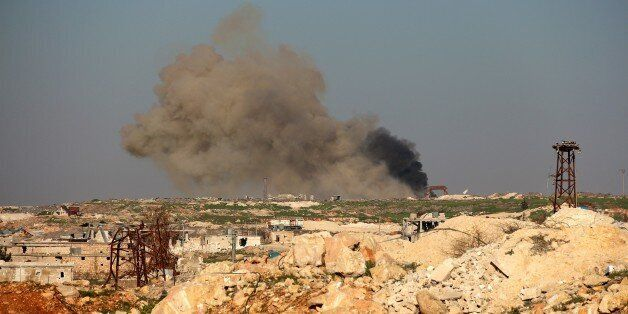 ALEPPO, SYRIA - FEBRUARY 03: Smoke rises during an ongoing fight against Syrian Regime Forces in Tal Mayyasat town of Aleppo,