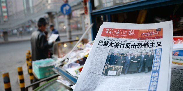 Chinese newspaper front pages show their coverage of marches held in response to the recent Islamist attacks that killed 17 p