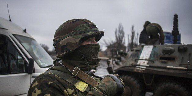 Ukrainian army soldiers resupply their battalion at the gate of Debaltseve, in the Donetsk region, on February 3, 2015. At le