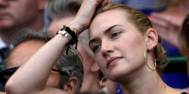 Actress Kate Winslett watch Andy Murray of Britain play Juan Carlos Ferrero of Spain in their quarterfinal singles match on c