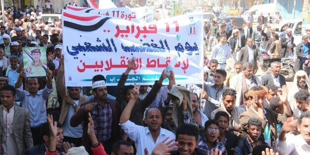 IBB, YEMEN - FEBRUARY 11: Hundreds march toward the municipality building during a demonstration rally to mark the fourth ann