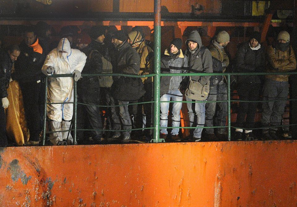 Migrants wait early on Dec. 31, 2014 aboard the Moldovan-flagged ship Blue Sky M. in the port of Gallipoli, in southeastern o