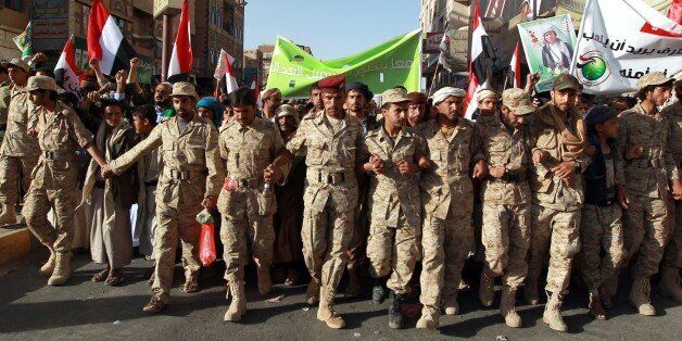 Yemeni supporters of the Shiite Huthi movement take part in a rally to commemorate the fourth anniversary of the start of the