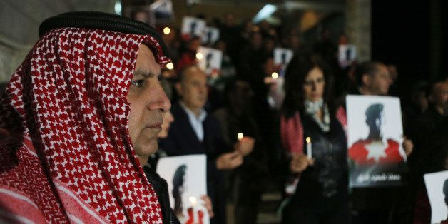 AMMAN, JORDAN- FEBRUARY 08:  Jordanian journalists hold a candlelight vigil expressing their solidarity for a pilot murdered