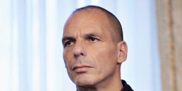 Greek Minister of Finance Yanis Varoufakis looks on during meeting between Belgian Prime Minister and Greek Prime Minister on