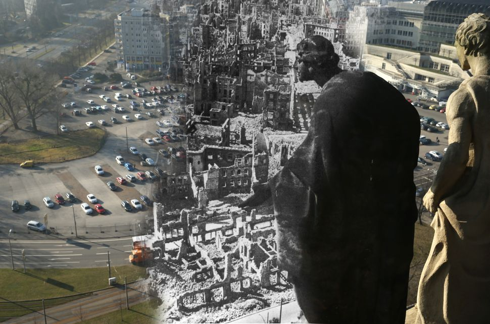 A statue on the tower of City Hall looking down at the ruins of the city center wrought by the Allied bombing of Feb. 13, 194