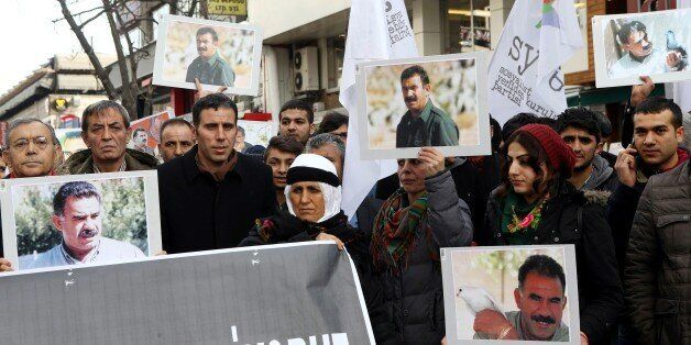 Members of the Kurdish community wave flags and banners of convicted Kurdistan Worker's Party (PKK) leader Abdullah Ocalan du