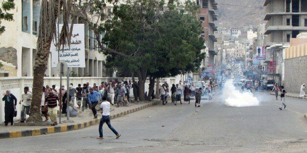 ADEN, YEMEN - FEBRUARY 15: Security forces intervene with tear gas as pro-separatist Yemenis stage a protest in Kraytar regio