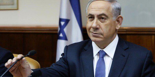 Israeli Prime Minister Benjamin Netanyahu prepares to speak as he opens the weekly cabinet meeting at his Jerusalem office on