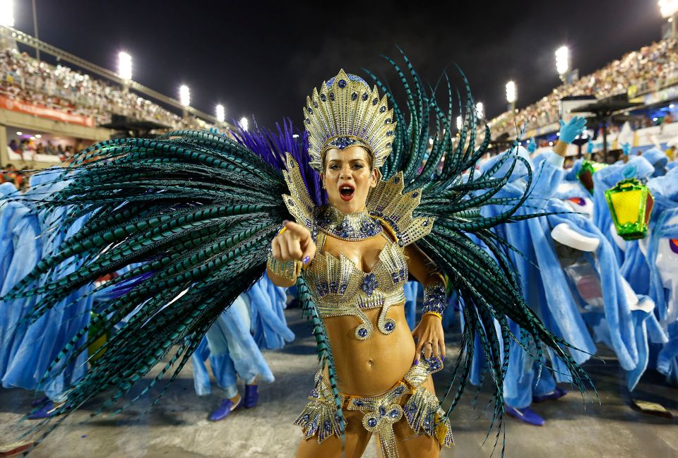 A performer from the Academicos do Grande Rio samba school parades during carnival celebrations at the Sambadrome in Rio de J
