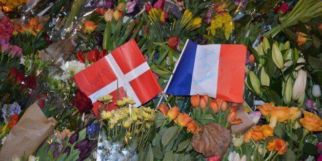 COPENHAGEN, DENMARK - FEBRUARY 15: Citizens of Copenhagen lay down flowers at the scene of a terrorist attack near the Krudto